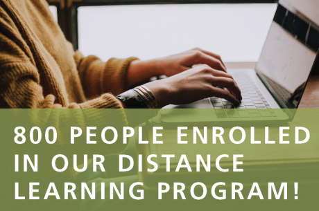 "A person types on a laptop. In the foreground against a semi-translucent green rectangle, white text reads ""800 People Enrolled in Our Distance Learning Program!"""