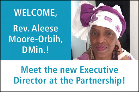 "Text in white reads, ""WELCOME, Rev. Aleese Moore-Orbih, DMin.!"" To the right is a photo of Dr. Moore-Orbih, a Black woman, wearing a purple and white African Head Wrap. ""Meet the new Executive Director at the Partnership"" is shown at the bottom in blue."