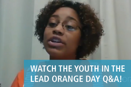 "Marissa Williams, a Youth Speaker at the Orange Day Q&A event, is speaking. She is a young black woman who wears glasses and an orange shirt. In front of her image is the text ""WATCH THE YOUTH IN THE LEAD ORANGE DAY Q&A!"" There is a semi-translucent blue background behind the text."