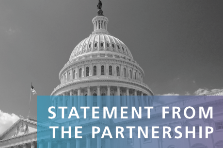 """STATEMENT FROM THE PARTNERSHIP"" is shown in white against a blue to purple gradient rectangle. The U.S. Capitol is shown in the background in black and white."