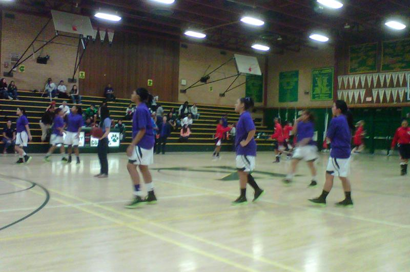 "Kennedy Varsity team members warming up in purple, ""the color for domestic violence awareness.""  Both school teams, all levels, and audience wore purple, as well as Kennedy Varsity coaches.  Thanks to Soroptimists Int'l of Sacramento for co-sponsoring the event and Kennedy JV Coach Russell Fong helping arrange it. This was the first such game in Sacramento, and perhaps in the state too!"